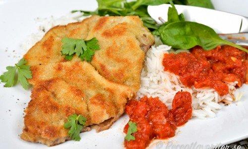 Piccata milanese är en ostpanerad schnitzel med tomatsås