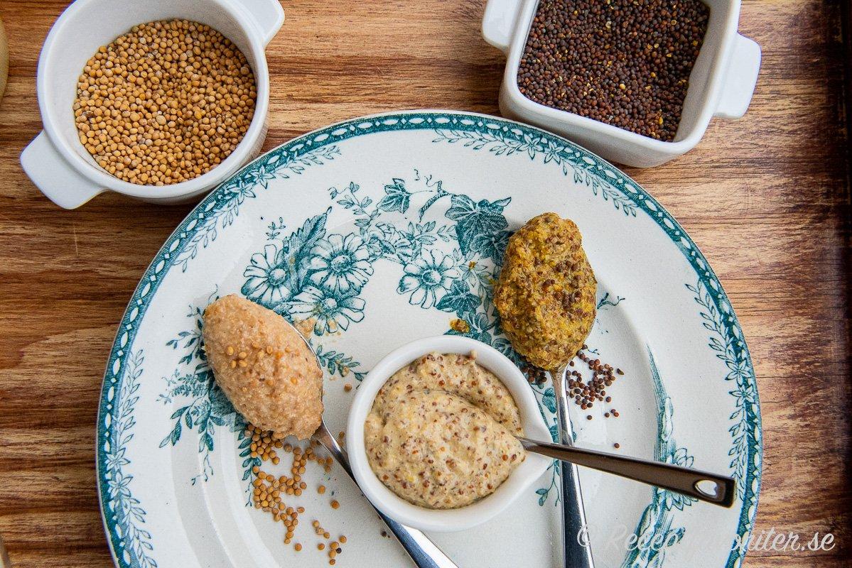 Gula och bruna senapsfrön till senapen på bricka